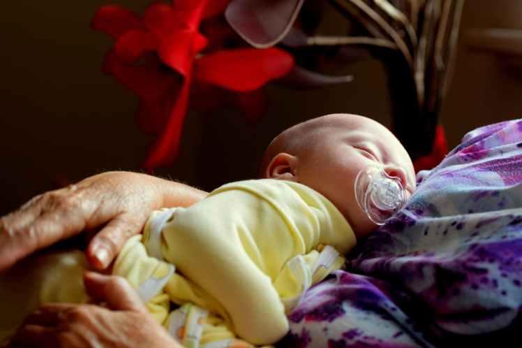 toddler sleeping while sucking pacifier